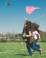 2 girls flying a kite