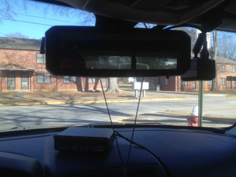 The new Digital-Ally video recorders are integrated into the patrol cars' rearview mirrors. Although some officer-citizen contact occurs outside the video frame, all officers assigned to the Uniform Patrol Division wear recorders on their uniforms that enable audio recordings to be captured remotely away from their vehicles.
