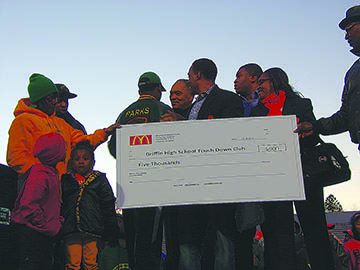 "At Wednesday's celebration of the Bears' championship victory, McDonalds presented the Griffin High Touch Down Club with a $5,000 check, which will in turn be given to Parks and his family, whose home was burglarized during the game. ""It was donated to Mr. Parks to his family. They donated it to us to give to him. We'll just give him the check,"" said Doug White, Griffin Football Booster Club president."