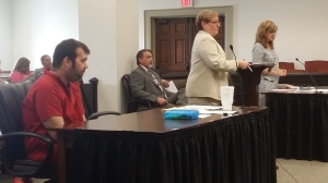 Michael Bowman, who stands accused of murdering Officer Kevin Jordan, of the Griffin Police Department, listened to arguments during his Tuesday afternoon preliminary hearing held before Spalding County Chief Magistrate Judge Rita Cavanaugh. Bowman is represented by Public Defender Diana Davis, center, and Spalding County Senior Assistant District Attorney Kimberly Schwartz, standing far right, is prosecuting the case on behalf of the state of Georgia.