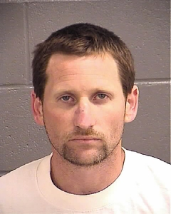 The Spalding County Sheriff's Office has arrested Dustin Joel Stevens, age 33, of 239 Westin Park Drive, Locust Grove, in connection with a Saturday shooting that left one woman hospitalized with a gunshot wound to the back.