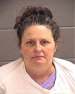 """Susan Collier, owner of the """"Griffin Mud Dogs"""" was on Wednesday sentenced to serve 60 days in jail and fined in excess of $4,000. The majority of those fines will be dismissed if Collier complies with an order to rehome all but four of the animals on her property and spay or neuter all that remain."""