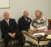 William Moore Sr. for most of the preliminary hearing sat with his head down.