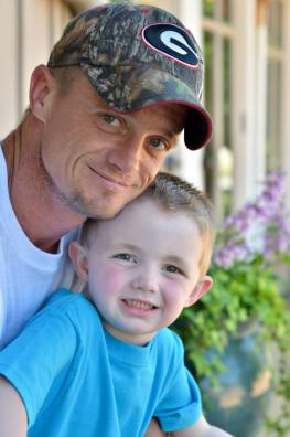 A $5,000 reward is being offered for information that leads to the arrest and conviction of the driver who struck and killed Shaun Wright, seen here with his young son. Wright was killed Feb. 19, in a hit and run collision on Old Atlanta Highway. Photos courtesy of the Spalding County Sheriff's Office.